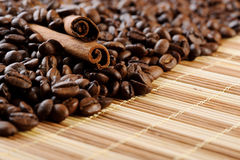 Handful aromatic coffee beans with cinnamon Royalty Free Stock Images