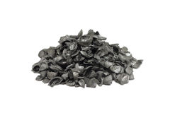 A handful of black charcoal pits of fruit Royalty Free Stock Photos