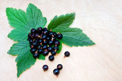 Handful of black currants on the board Royalty Free Stock Image