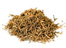 Handful of black elite tea. On white background Stock Images