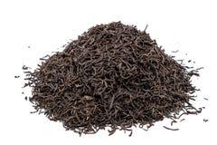 Handful black Lapsany tea isolated on white background. Royalty Free Stock Photos