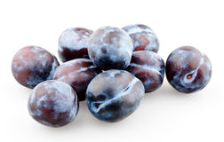 Handful of black plums. On white background stock photography