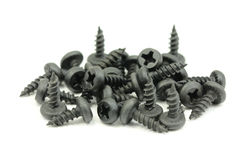 A handful of black screws d Stock Photo