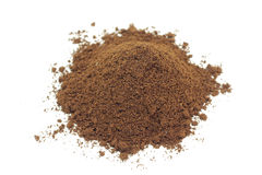 A handful of brown powder of ground coffee Royalty Free Stock Images