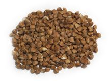 Handful of buckwheat. On white background Stock Photo