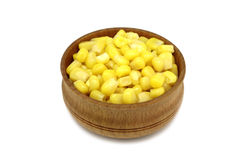 A handful of canned corn in a wooden bowl Royalty Free Stock Photos