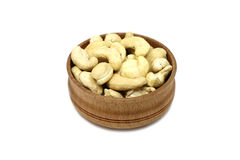 Handful of cashew kernels in a wooden bow Royalty Free Stock Photo