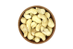 Handful of cashew kernels in a wooden bowl Stock Photography
