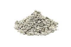 A handful of cement rubble. On a white background stock image