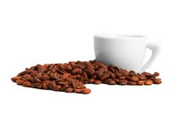 Handful of coffee beans and cup Stock Photos