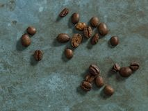 Bunch of coffee on emerald royalty free stock photography