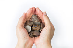 Handful of coins holding in person palm Stock Images