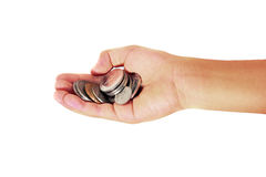 A handful of coins in the palm of a hand Royalty Free Stock Photos