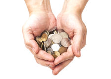 Handful of coins in palm hands Royalty Free Stock Photos