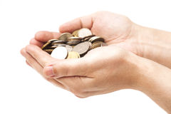 Handful of coins in palm hands Royalty Free Stock Images