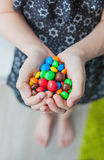 Handful of colored candy in the hands Royalty Free Stock Photo