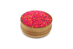 A handful of colored millet in a wooden bowl Royalty Free Stock Images