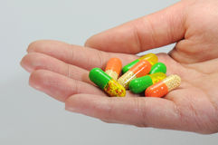 A handful of colorful capsules Stock Photo