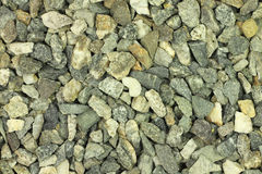 A handful of construction gravel gray background Stock Photos