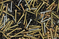 Handful of construction screws  background Stock Photo
