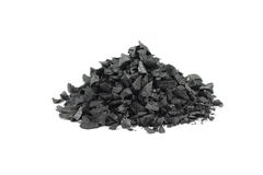 A handful of crushed charcoal. On white background Stock Photography