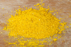 Handful of curry powder Stock Photos
