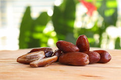 A handful of dates on the wooden table Stock Images