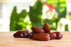 A handful of dates on the wooden table Royalty Free Stock Photography