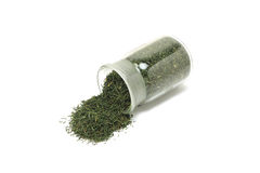 A handful of dried dill in a glass bottle Stock Photography