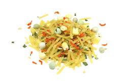 A handful of dried noodles with vegetables. On a white background Royalty Free Stock Images