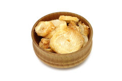 A handful of dried octopus meat in a wooden bowl Royalty Free Stock Photos