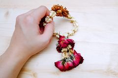 Handful the Dry Jasmine and Rose Flower Wreath Thai. On the Table Wooden Stock Photography