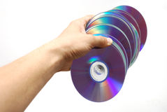 Handful of DVDs. Many DVDs in a hand Royalty Free Stock Photo
