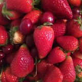 Fresh and juicy strawberries and cherries stock photography