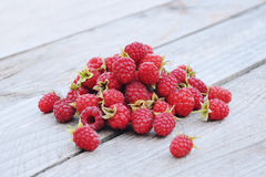 Handful of fresh ripe raspberries on rustic wooden background Royalty Free Stock Image