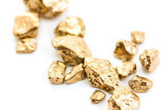 Handful of gold nuggets close-up Stock Images