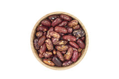 A handful of grains of red beans in a wooden bowl Royalty Free Stock Photo