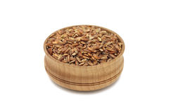A handful of grains of rice in a wooden bowl Royalty Free Stock Photography