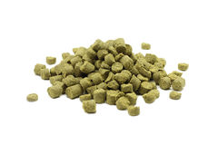 Handful of granulated green hops. On white background Stock Image