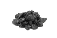 A handful of gravel bitumen plastered Stock Photography