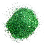 Handful of green glitter sparkle on white background Royalty Free Stock Photography