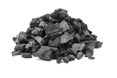 A handful of ground charcoal. On white background Stock Photos