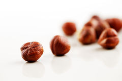 A handful of hazelnuts on a white background Stock Image