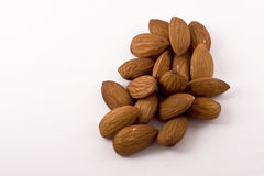 Handful of Healthy Raw Almonds. A handful of raw almond nuts on a white background Stock Images