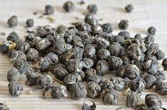 Handful of Jasmine Pearl Green tea Royalty Free Stock Photo