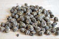 Handful of Jasmine Pearl Green tea Stock Photos