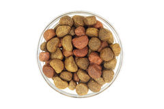 A handful of kibbles pet food in a glass cup Stock Photo