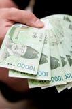 Handful of Korean Won Stock Photography