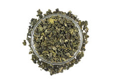 A handful of loose green tea in a glass container Royalty Free Stock Images