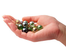 Handful of marbles Stock Image